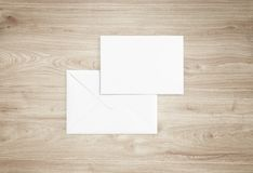 White blank envelope mockup and blank letterhead presentation template. White envelope and post card on a background, top view. Blank envelope mockup and blank Stock Photo