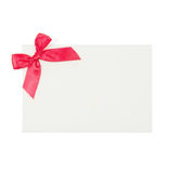 White Envelope with a Stylish Red Ribbon Stock Photo