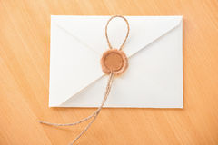 White envelope on wooden table. Royalty Free Stock Images