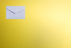 White envelope on yellow color Royalty Free Stock Photo