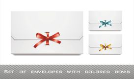 White envelopes with colored bows Royalty Free Stock Photos