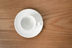 White espresso cup on a wooden plate Royalty Free Stock Image