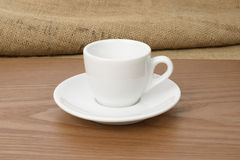White espresso cup on a wooden plate Stock Image