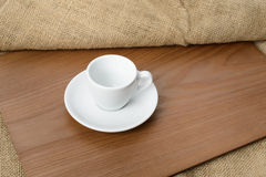 White espresso cup on a wooden plate Stock Photography