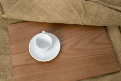 White espresso cup on a wooden plate Stock Images