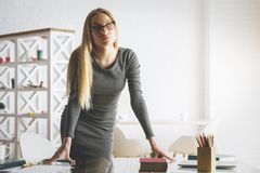White european woman leaning on desk Royalty Free Stock Images