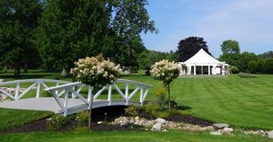 White events tent on a summer`s day. White events or wedding tent with a blue & cloudy sky royalty free stock photography