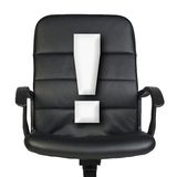 White exclamation mark stands in chair. Isolated Stock Photography
