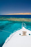 The white excursion yacht moored beside the island Giftun Royalty Free Stock Image