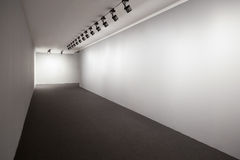 White exhibition room. Presentation White Room, Wall For Images, Empty Wall, Exhibition Room Lights, Gallery Interior, Lighted Wall, Exhibition Room, Showroom royalty free stock images