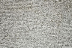 White exterior wall covering. White decorative covering of the exterior house wall close up royalty free stock images
