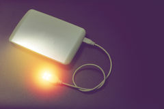 White external hard drive and red spot like data for backup on b Royalty Free Stock Photo