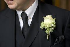white för dräkt för svart knapphålman rose arkivfoton