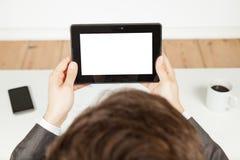 white för tablet för bakgrundsaffärsmanholding arkivfoto