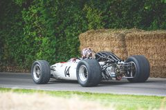 White F1 Car Near Haystack Royalty Free Stock Images