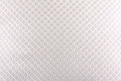 White Fabric Background. A background of a white fabric with an abstract design of diamond shapes on it Stock Images