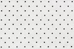 White fabric with black dots as background. royalty free stock photography