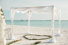 White Fabric Canopy Tent With Green Heart Floor Decor at Beach stock images