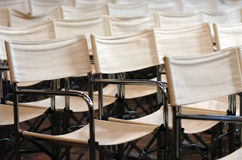White fabric chairs. A series of white fabric collapsible chairs Stock Images
