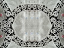 White fabric with crochet ornaments Royalty Free Stock Photo