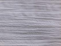 White fabric with a crumpled effect and horizontal creases. White background with crumpled fabric structure royalty free stock images