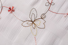 White fabric with floral embroidery Royalty Free Stock Photography