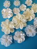 White fabric flowers-bands. On blue background Stock Photo