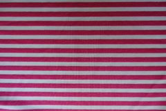 White fabric with horizontal pink stripes. From above Royalty Free Stock Photos