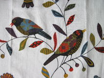 White fabric with painted birds Stock Images