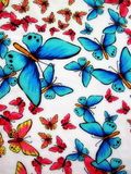 White fabric with painted butterflies. White fabric with colorful painted butterflies Royalty Free Stock Photos