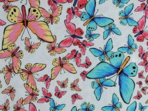 White fabric with painted butterflies Royalty Free Stock Photo
