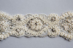 White fabric pieces, lace, design dresses, clothing for celebrations Royalty Free Stock Images