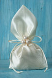 White fabric pouch tied with string Royalty Free Stock Image