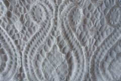 White fabric with retro styled lacy pattern Stock Image