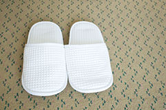 White fabric shoes on carpet Stock Image