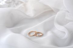 White  fabric and wedding rings Stock Photography