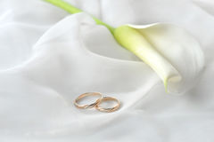 White  fabric and wedding rings Royalty Free Stock Photography