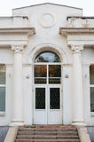 White facade with doors and columns Royalty Free Stock Images