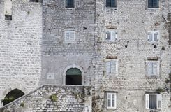 Stone built houses of old, medieval town. White facade of stone blocks and white windows on old mediterranean houses, Šibenik, Croatia Stock Photo