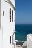 White facade wall and yellow and blue ocean in Tangier,Morocco Royalty Free Stock Photos