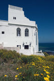 White facade wall and yellow flowers in Tangier,Morocco Royalty Free Stock Image