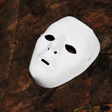 White face mask for Halloween. White phantom of the opera half face mask. Halloween mask Royalty Free Stock Photography