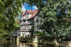 White fachwerk houses in Erfurt, Germany. White fachwerk houses on the river Gera in the park in Erfurt, Thuringia, Germany Stock Photos