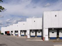 White factory and loading dock Royalty Free Stock Photos