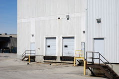White factory and loading dock Royalty Free Stock Photo
