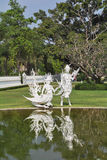 White fairy sculptures of winged creatures Stock Photos