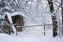 White Fairy Tale - Winter Forest and Village. Mysterious tale of snow and winter trees. Iron broken gates and a lost village stock images