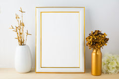 White fame mockup with white and golden vases Royalty Free Stock Images