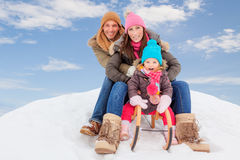White. Family sliding winter couple enjoying season Stock Photography