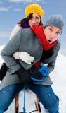 White. Family sliding winter couple enjoying season Stock Photos